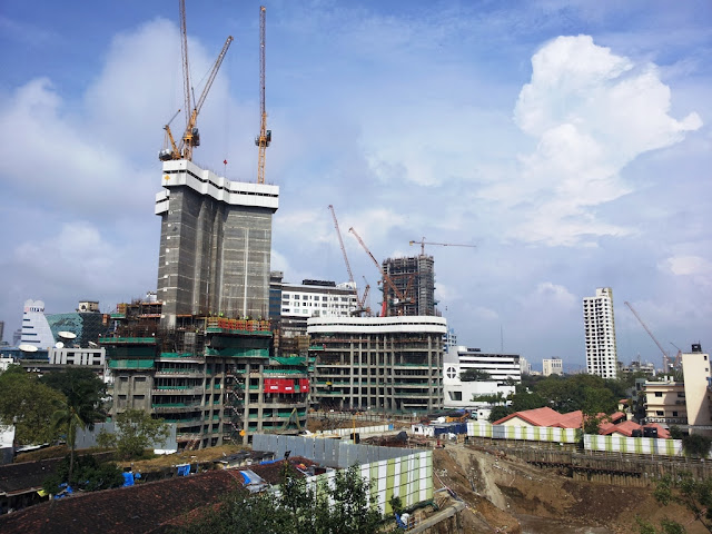 Photo of World One Skyscraper and other buildings around under construction