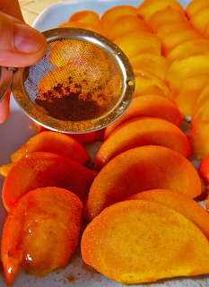 Hand Sprinkling Persimmons with Apple Pie Spice
