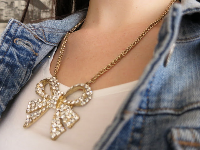 Sparkly bow necklace, cream t-shirt and denim jacket