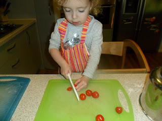 Cutting up tomatoes for homemade pizza recipe