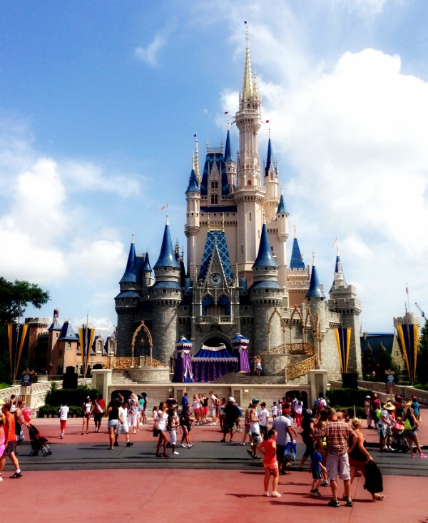 Winding Down | Morgan's Milieu: Cinderella's Castle, surrounded by people, on a sunny day.
