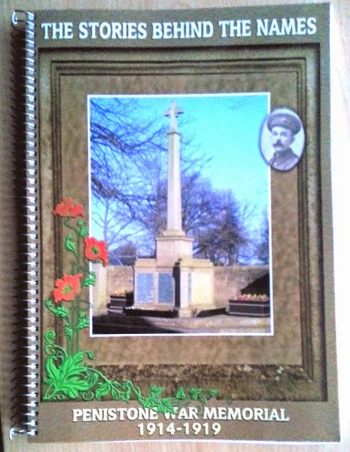 The front cover of the book described in the text.  It has a picture of a large cross surmounted war memorial framed in mock wood with a trailing poppy at the lower left corner.  One oval picture of a First World War Serviceman has been superimposed at the top right.