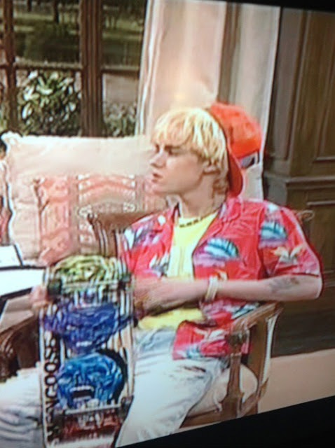 Justin Bieber wearing the blonde wig in the SNL