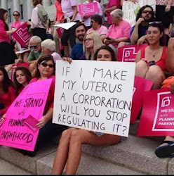 Protester Kicks Against Regulating The Female Uterus