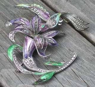 unsigned lily and hummingbird brooch
