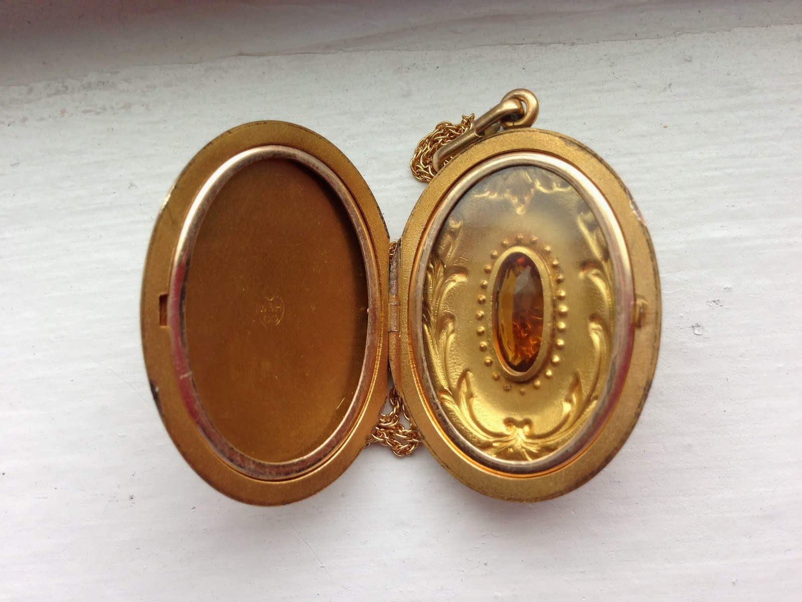 memorystation  large antique edwardian gold filled oval locket with repousse design and paste