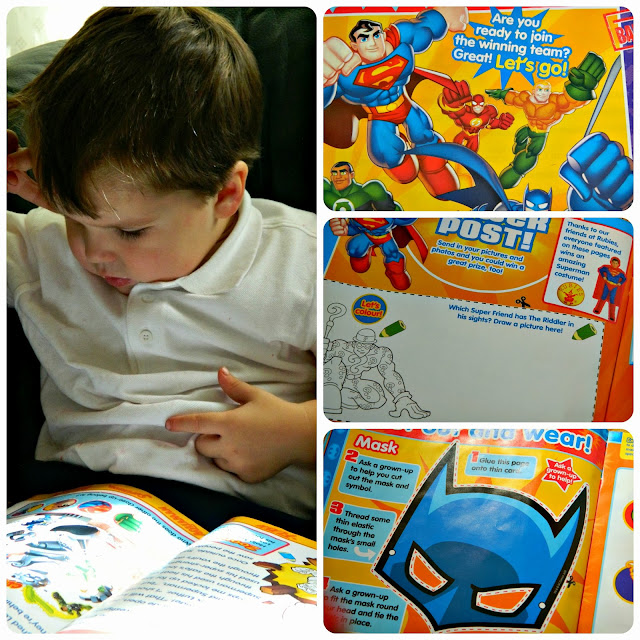 Small boy reading Issue One of DC Super Friends Magazine Comic Batman Superman Green Lantern Flash pages activities makes