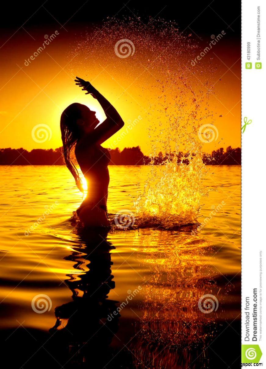 Girl Swimming And Splashing On Summer Beach Stock Photo   Image