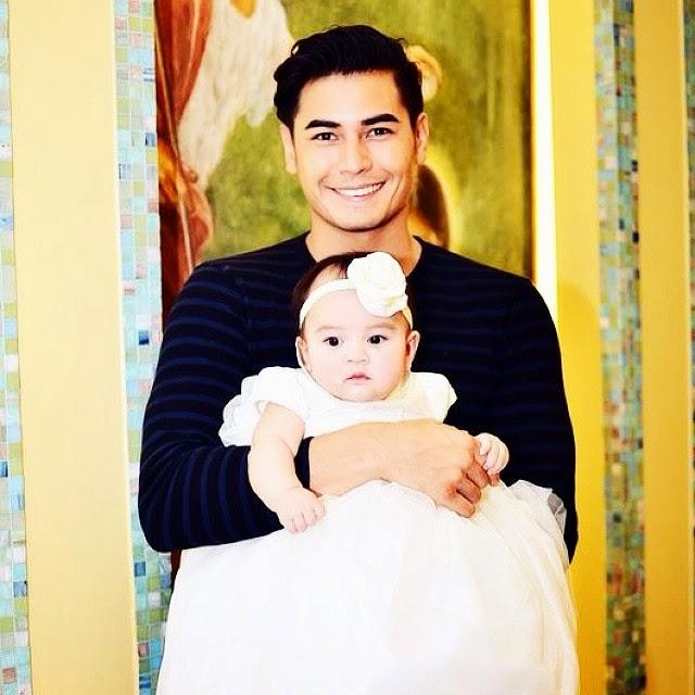 Fabio Ide and his daughter with Denise Oca