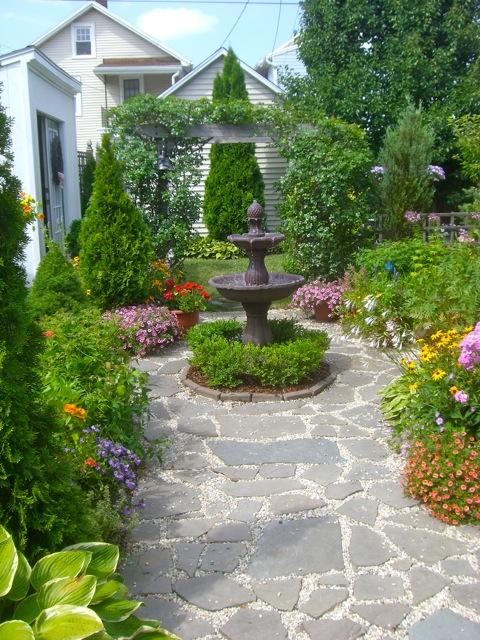 A formal garden in an informal world for Informal garden designs