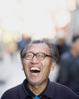 China stock photo of a laughing man by Shannon Fagan.