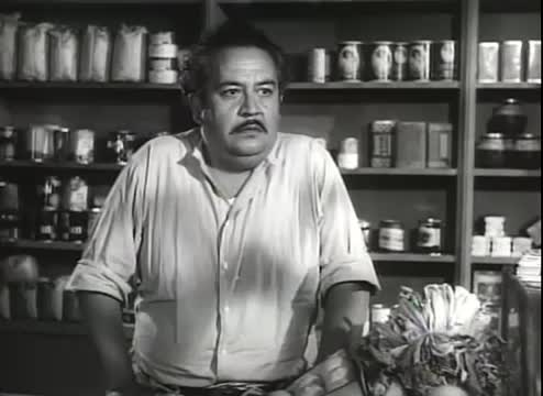 The Mexican Shop-Keeper In The Hitch-Hiker -- 1953