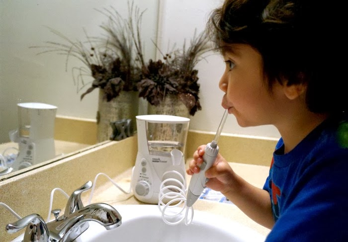 Tips for keeping your kids' teeth healthy | LivingMiVidaLoca.com #NewAgeInWaterFlossing