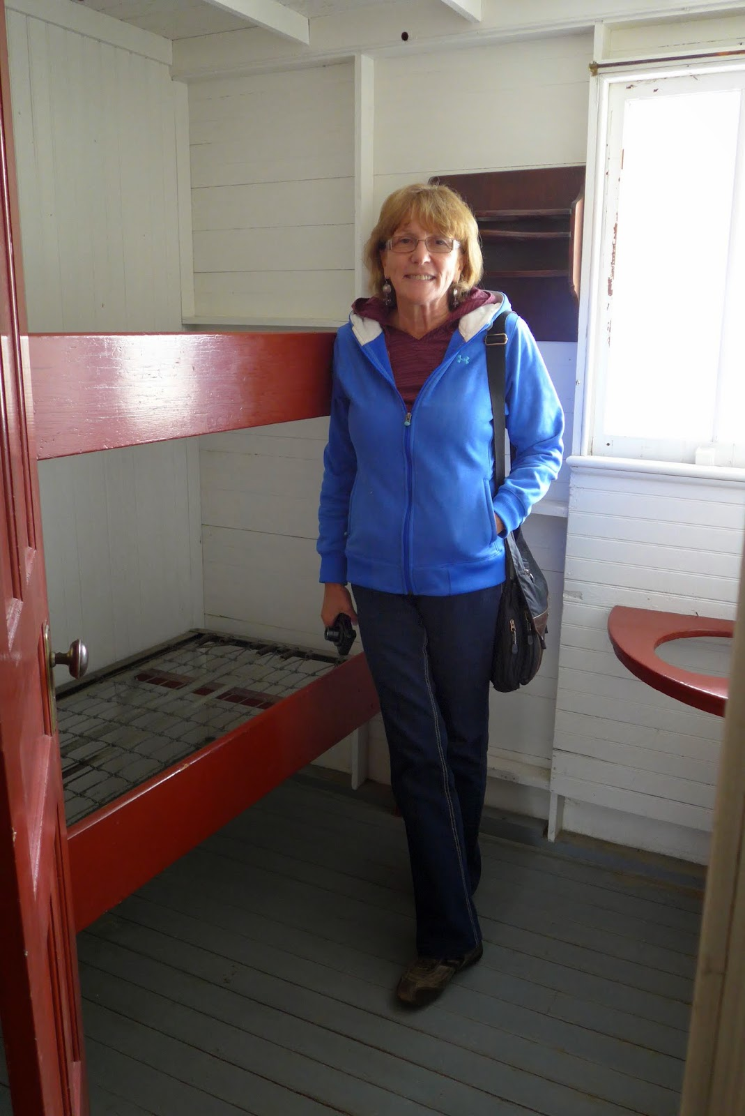 Liz in a state room. Pretty small beds.