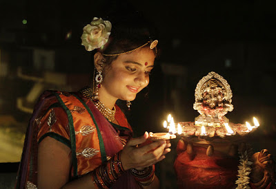 Woman celebrates Diwali in India