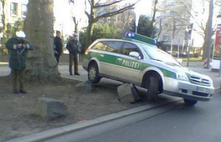 funny photo German police car collided against a stone