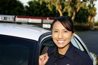 A young female Hispanic police officer.