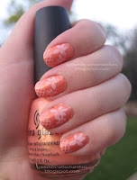 Peaches and cream floral and fishnet manicure