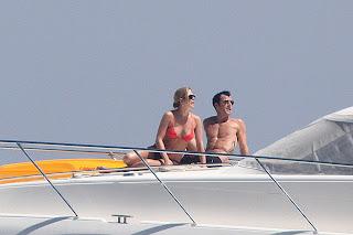 Jennifer Aniston orange Bikini top on boat in Capri
