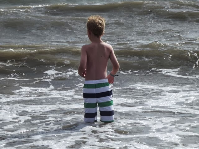 boy jumping waves