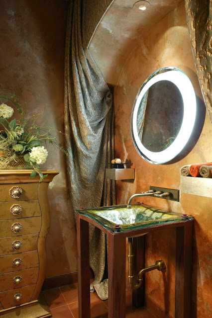unique and rather gothic powder room decorated with curtains and soft plastered wall
