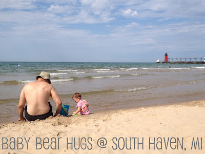 dad and child on the beach with a sand castle South Haven, MI