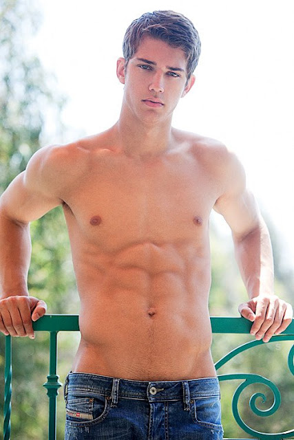 shirtless boy on a balcony