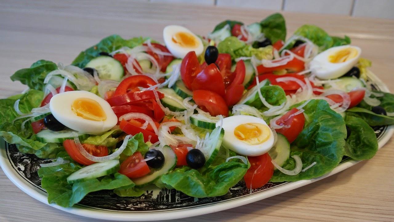 salad, egg, tomato, lettuce, olives