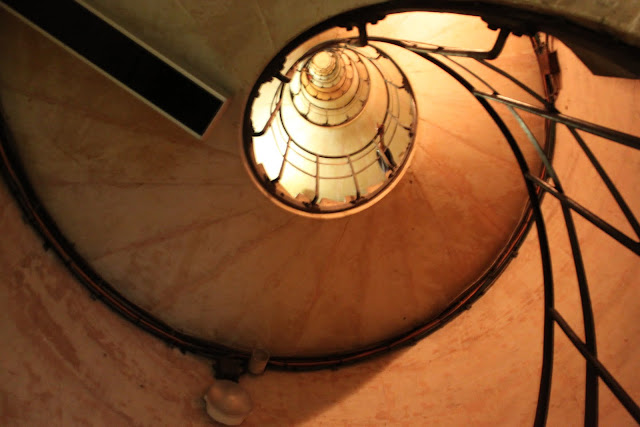 Walk on 284 steps of the spiral stair to the top level of Arc de Triomphe in Paris, France