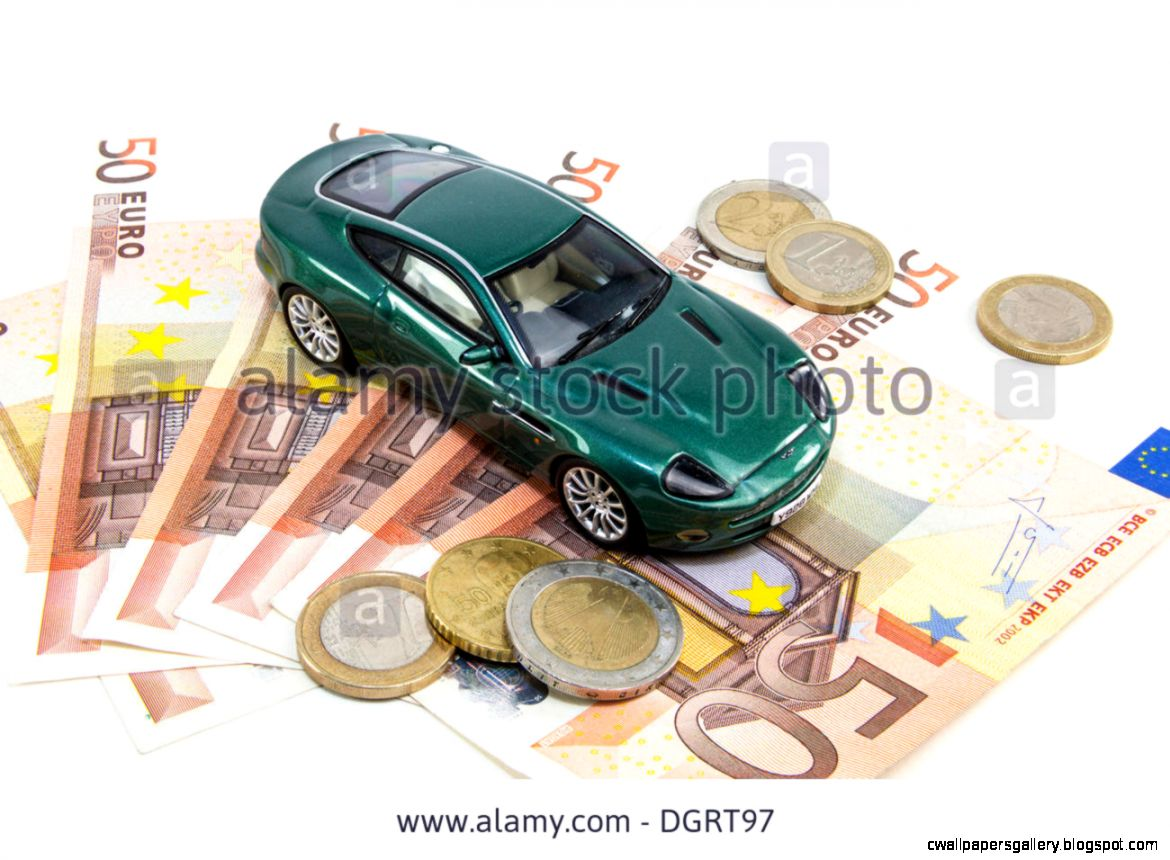 Toy Car With Euro Banknotes And Euro Coins Symbolic Image For