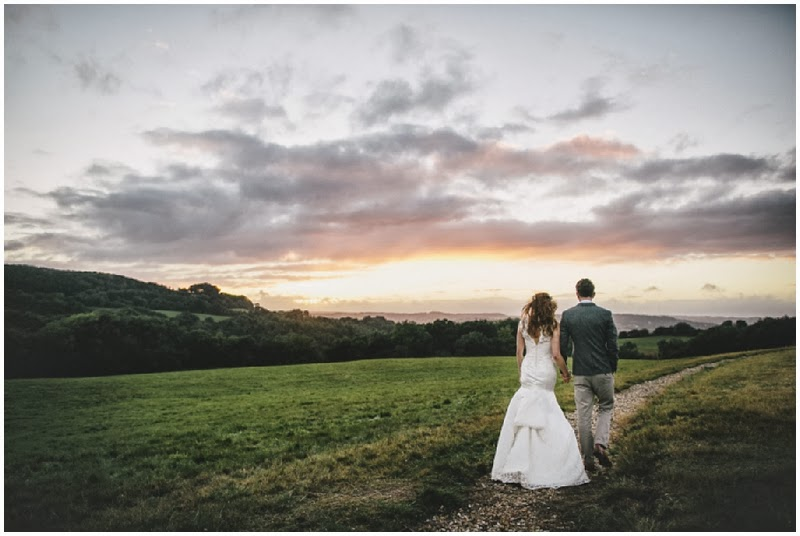 Bride and groom at sunset at River Cottage HQ in Devon