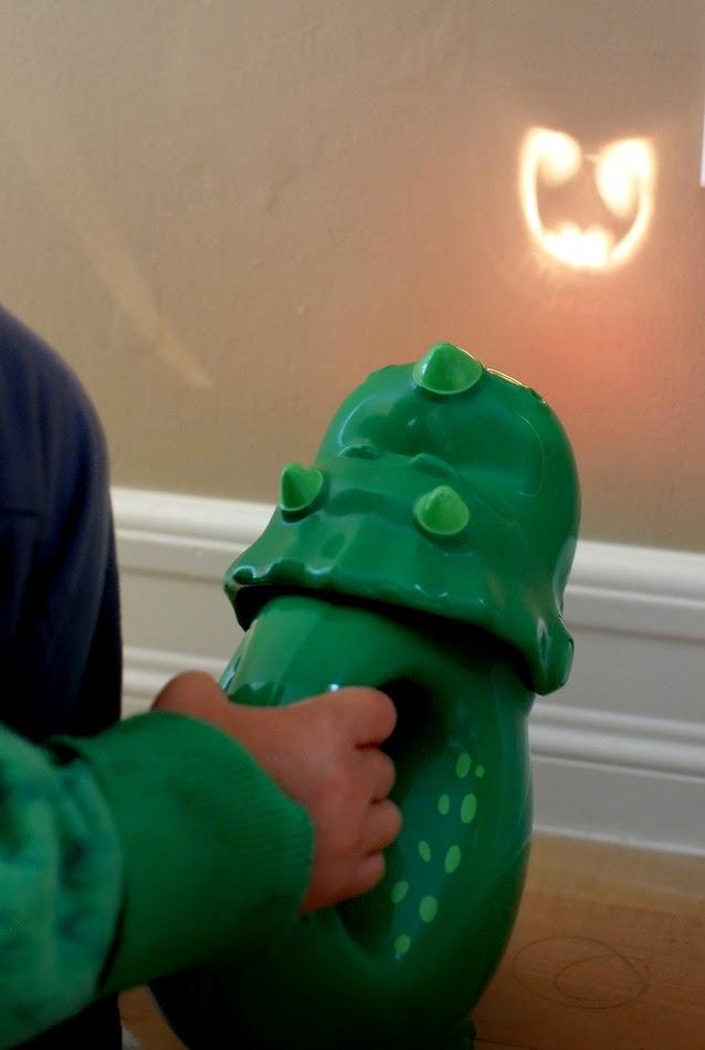 Kid shining a DIY Bat Signal