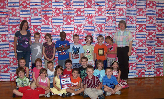 "photo of: Monumental Construction Paper Quilt by Carie's Kindergarten Class in Response to ""Red, White and Blue"" by Debbie Clement"