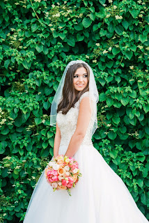 model wears a bridal gown and full veil on a wedding dress shoot