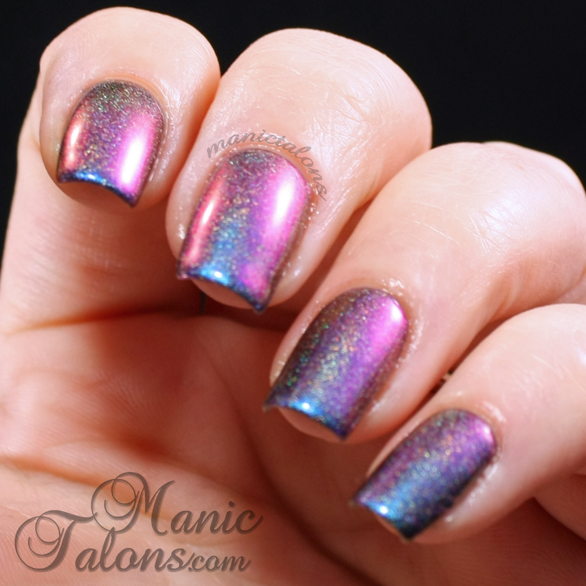 Girly Bits Go and Shake a Tower swatch over black gel polish