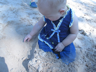 Grandbaby feeling the sand -Vickie's Kitchen and Garden