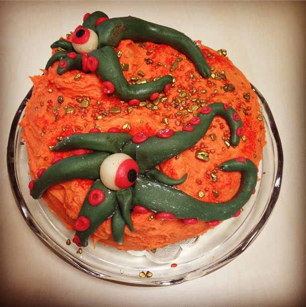 Martian cake coloured orange with green tentacles