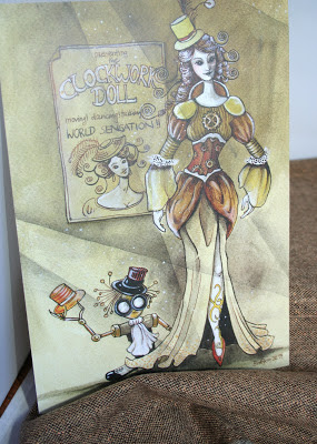 a photo of an art card of a steampunk lady and her little robot and some tweed fabric.