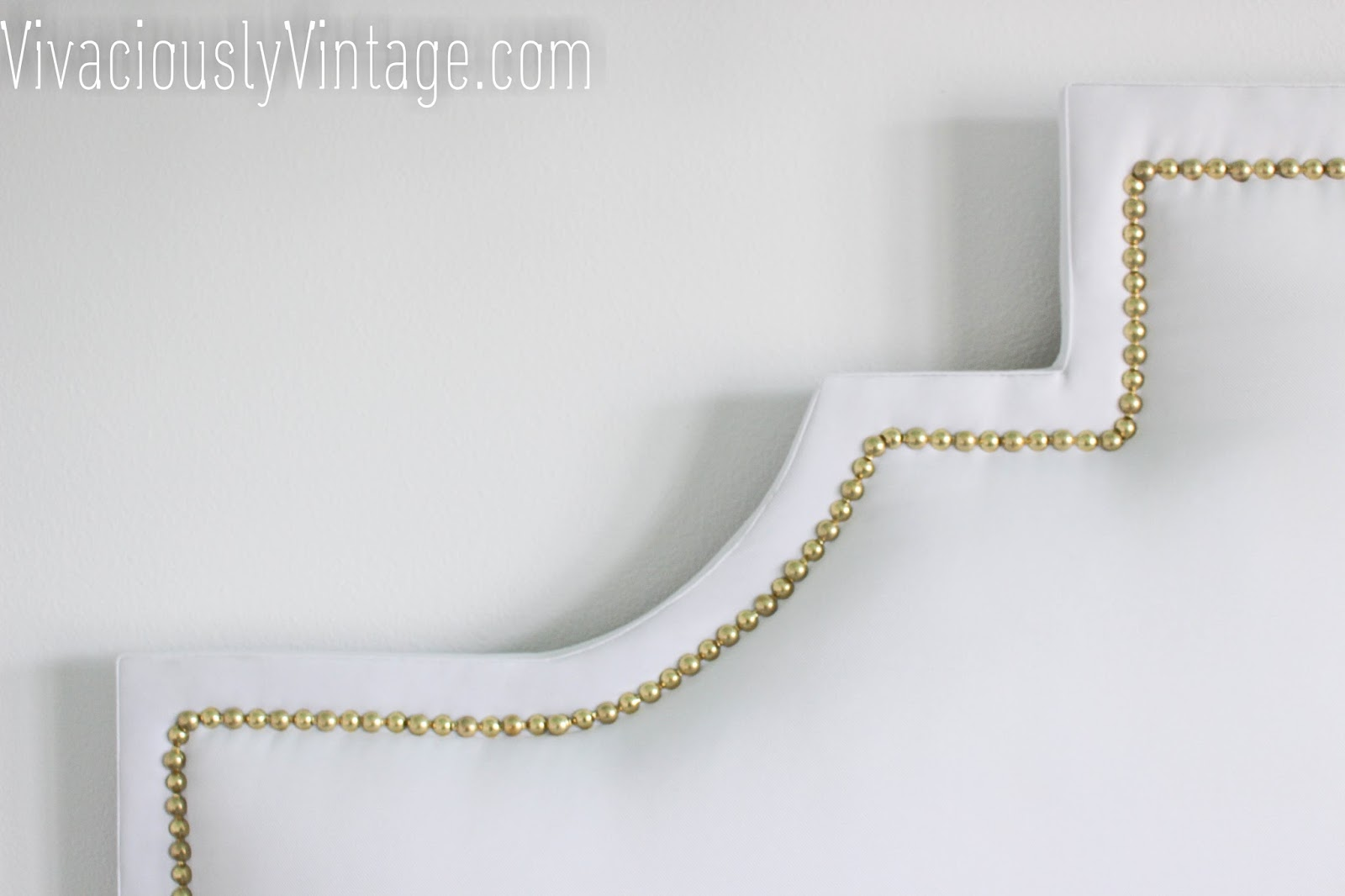 diy upholstered crib headboard with nailhead trim