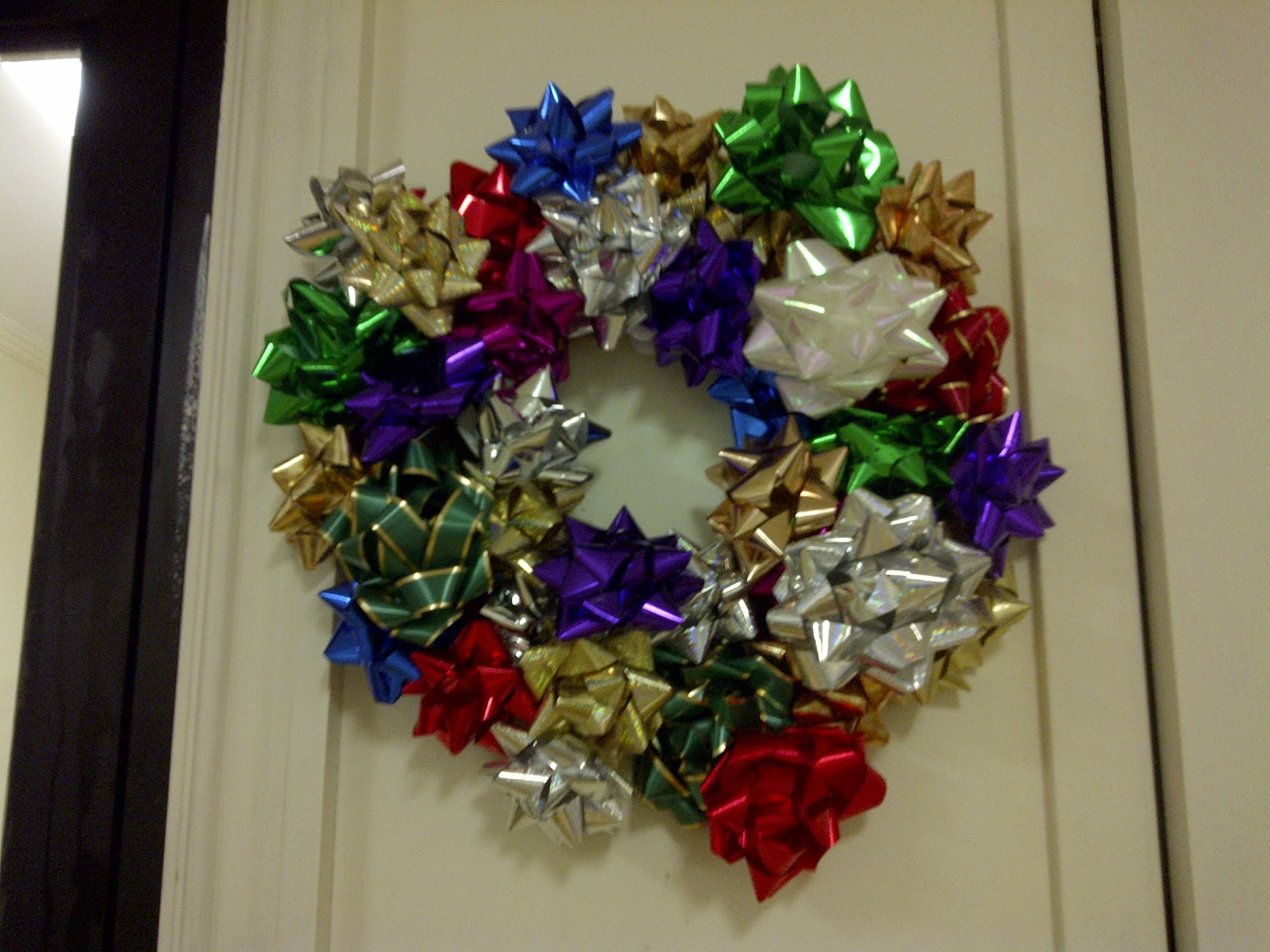 then add your bows with hot glue and voila youve now got a cute christmas craft that takes no time at all