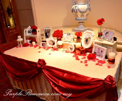 Photo Table Display or Love Corner Table Decoration, Red Black Lace Wedding Decoration at Renaissance Hotel Kuala Lumpur, petals, floating candle, walkway, aisle, flower stand, floral, red roses, ballroom, selangor, malaysia, elegant, vibrant, special, unique, wedding day, VIP table centerpiece, block candle, posie, chair tie back, maroon, entrance flower arch, reception table decoration, teddy bear, crystal candle light holder, bride side, groom side, table runner, tea candle, red roses with pearl, maroon satin fabric scallop, design, draping