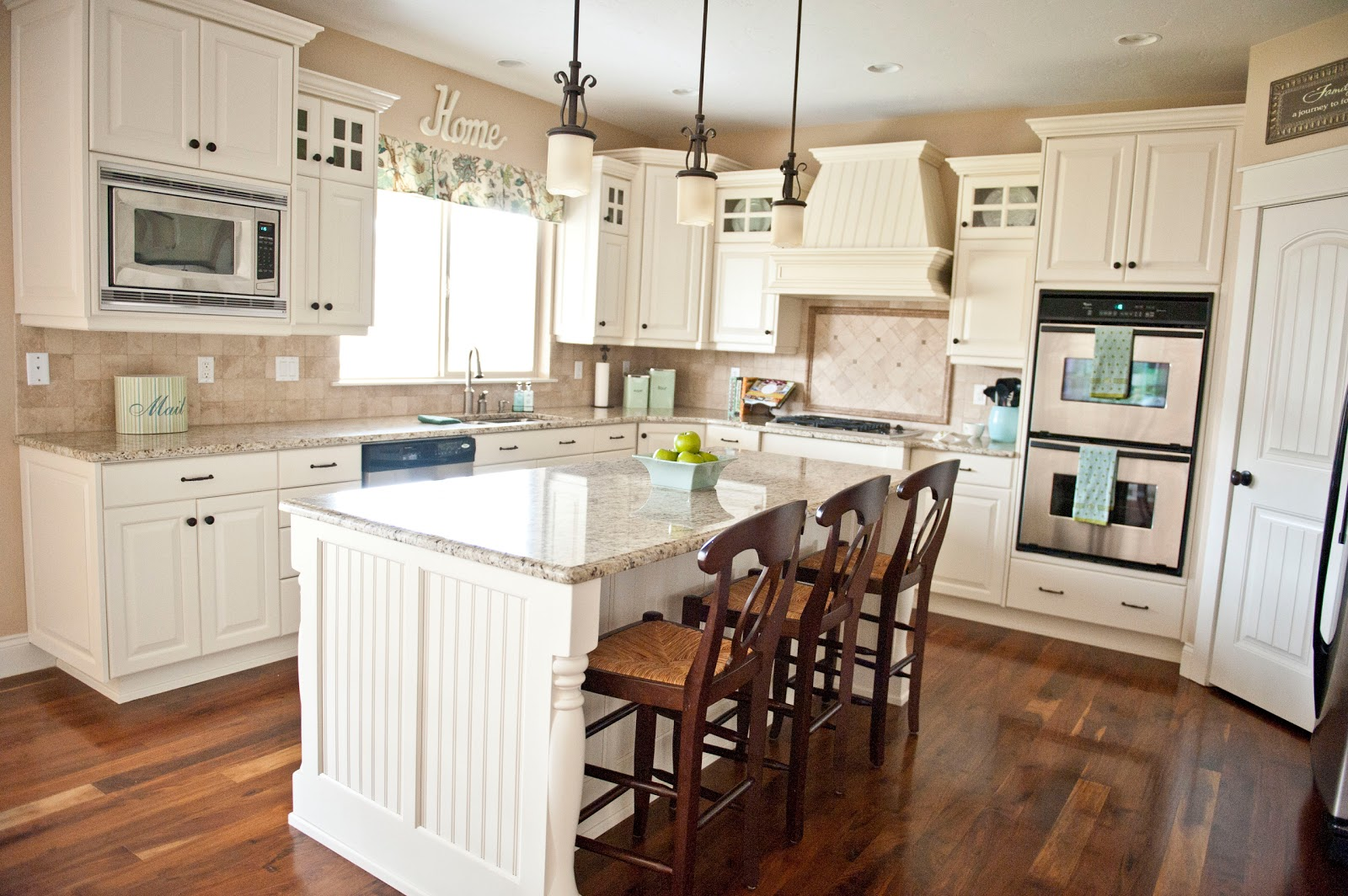 My home tour kitchen sita montgomery interiors for Painting wood kitchen cabinets white