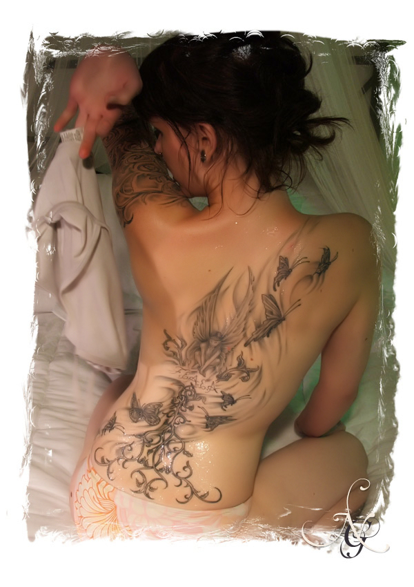 sexy back tattoos. lower ack butterfly tattoos.