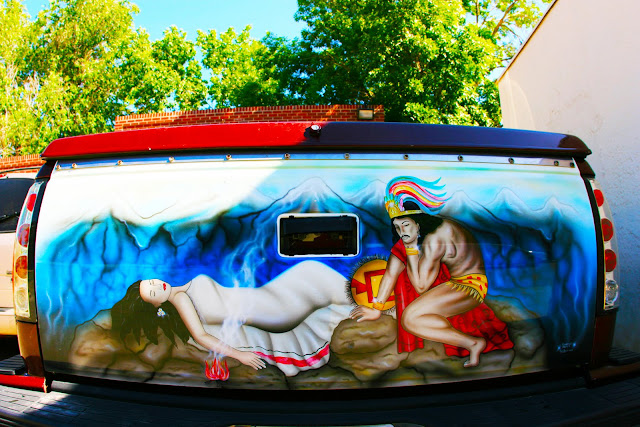 A very strange scene painted on the tailgate of a pickup truck in Arvada, Colorado.