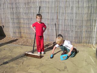 slave labour sweeping the back yard