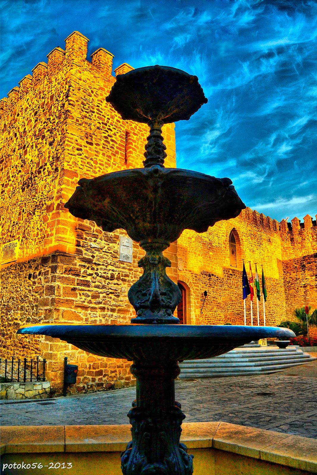 Almenas del castillo y la fuente Rota
