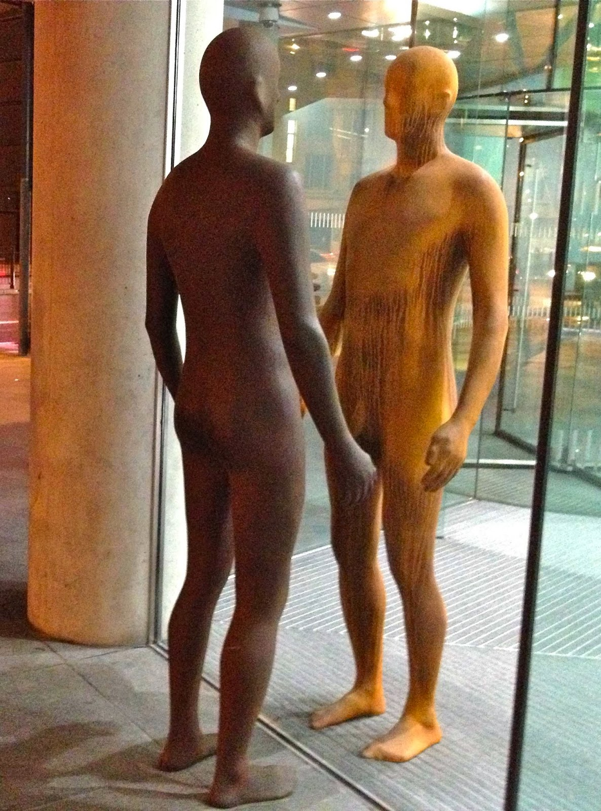 statues of 2 men facing each other
