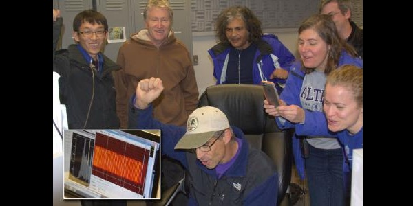 The team celebrates the first detection of light from the laser comb with the NIRSPEC instrument (inset) at the Keck II telescope. (From left to right): X. Yi, K. Vahala, G. Doppmann (front, seated), G. Vasisht, S. Leifer, M. Fitzgerald, and E. Martin (front, right). Credit: Credit: Charles Beichman