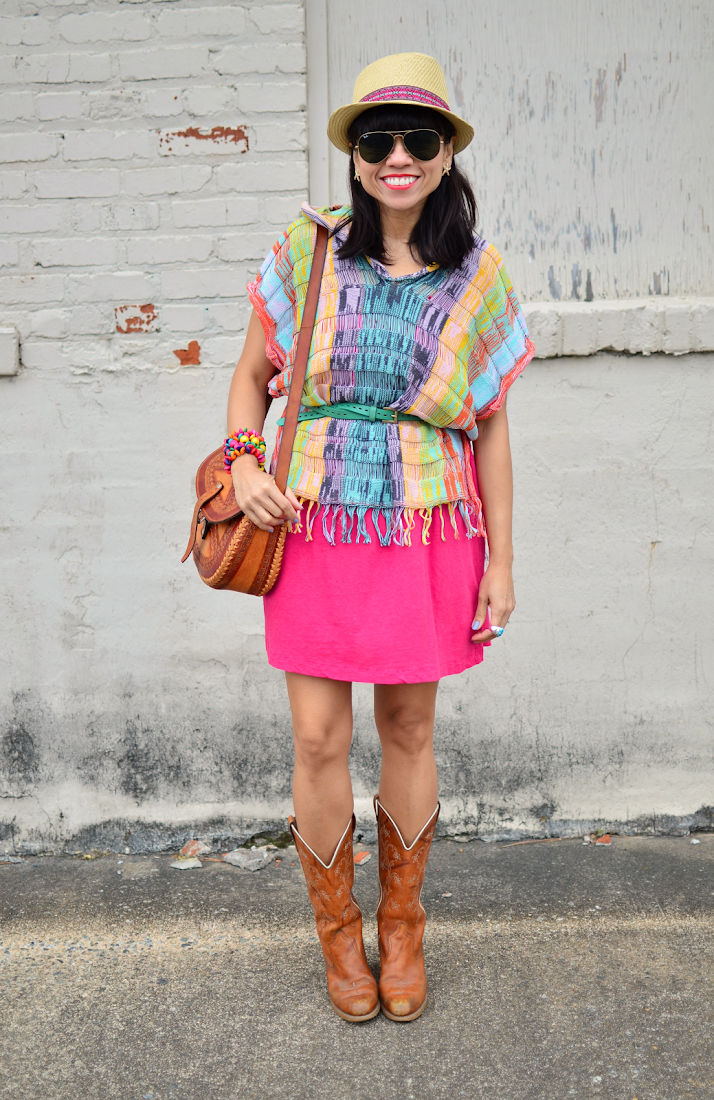 Wearing cowboy boots and poncho