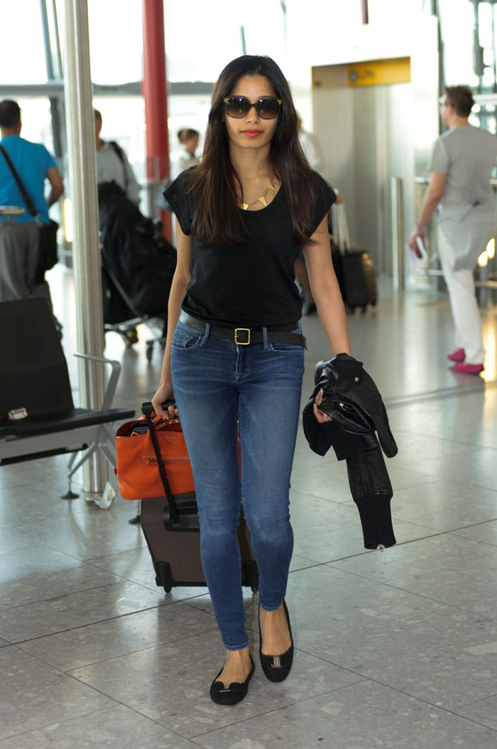 Freida Pinto at Heathrow Airport in London